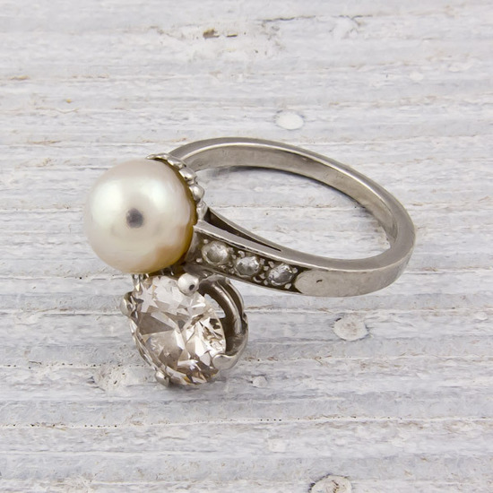 Elegant pearl and diamond vintage engagement ring
