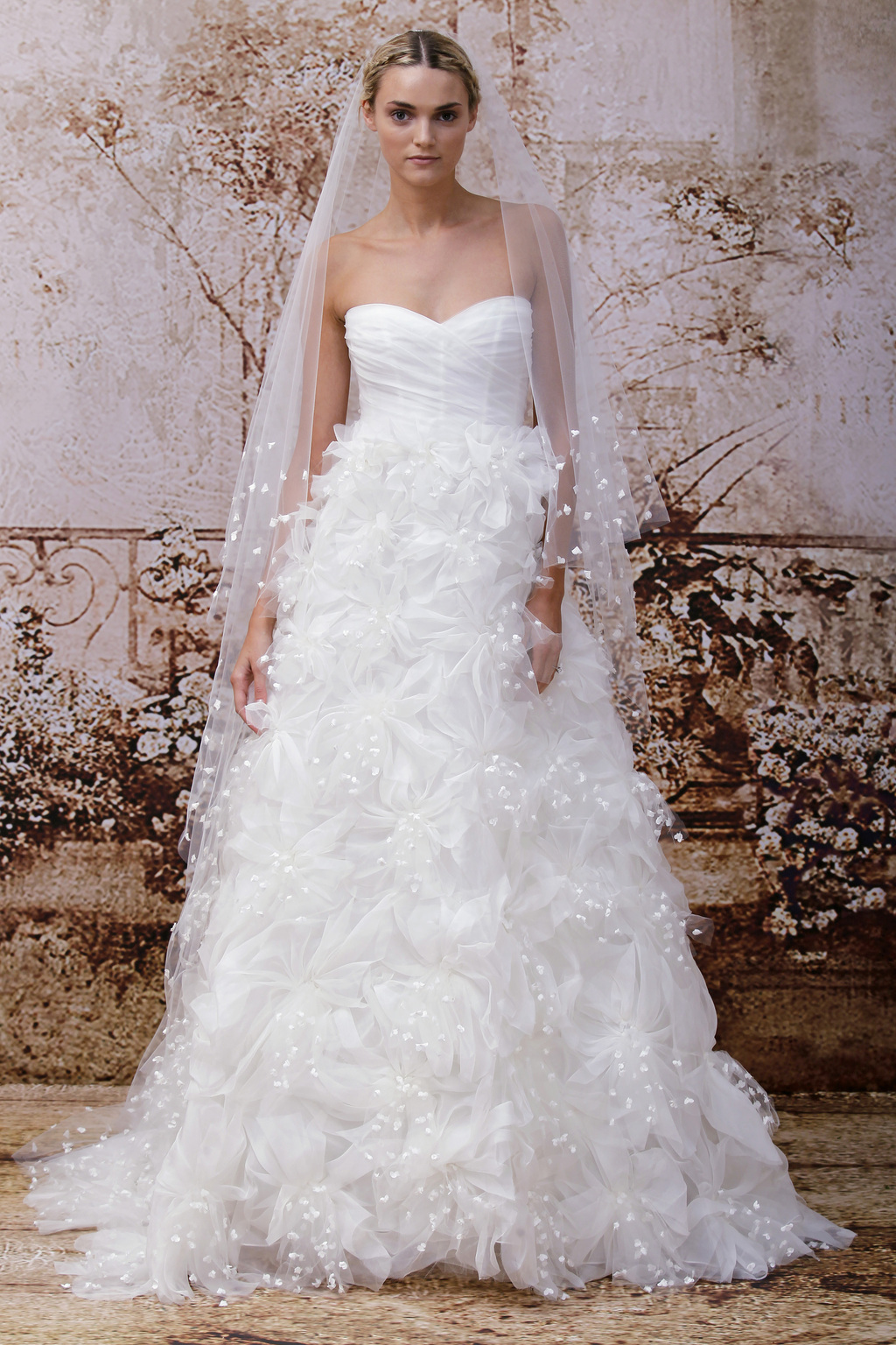 Petal-adorned-wedding-veil-coordinating-with-the-monique-lhuillier-dress.full