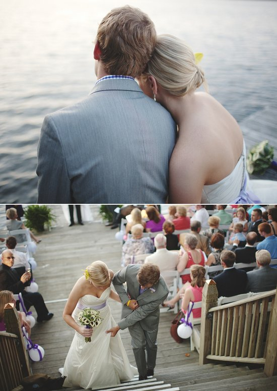 Bride and groom pose on dock near outdoor wedding venue