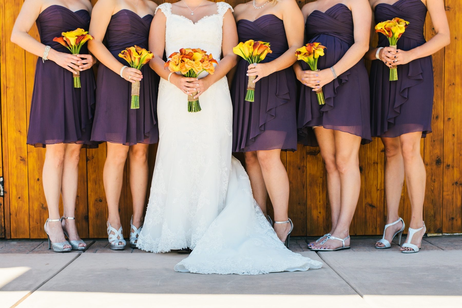 bridesmaids wear eggplant purple dresses with silver heels