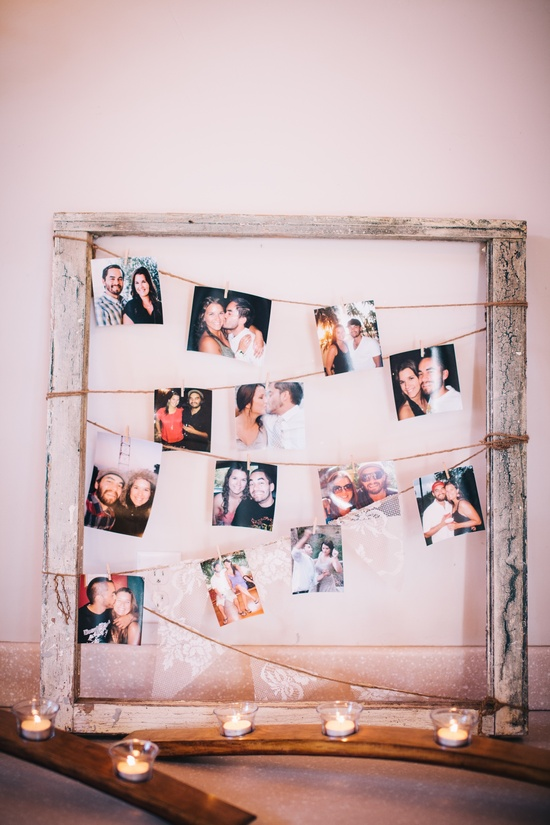 wedding reception DIY with couples photos hanging from a frame