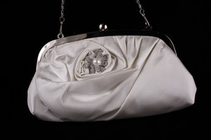 photo of Ivory satin bridal clutch by PowderBlueBijoux