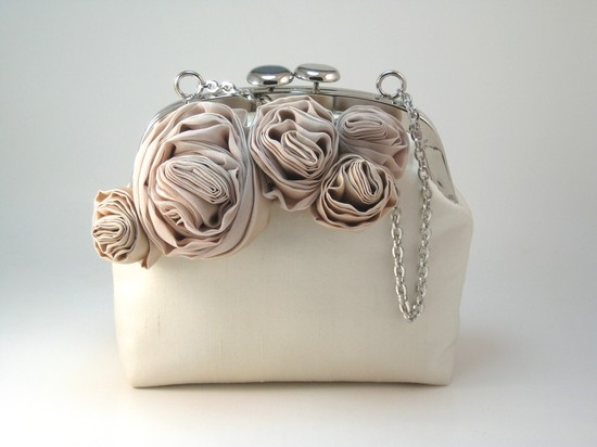 Romantic champagne and blush rose-adorned wedding clutch