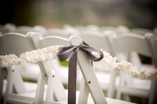 ruffled wedding ceremony aisle decor with mauve ribbons