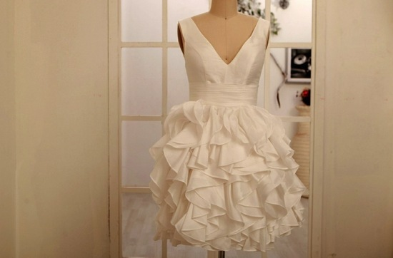 little ivory wedding dress with ruffled skirt