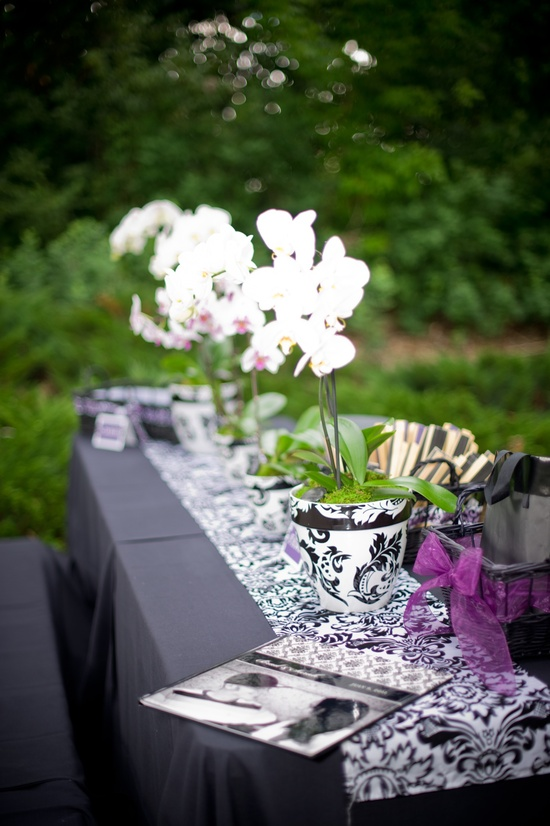 Outdoor wedding reception tablescape with orchid wedding flowers
