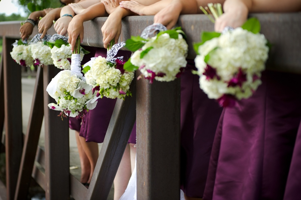 Real-wedding-bridesmaids-hold-ivory-hydrangeo-bouquets-purple-bridesmaids-dresses.full