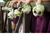Real-wedding-bridesmaids-hold-ivory-hydrangeo-bouquets-purple-bridesmaids-dresses.square