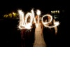 Bride-groom-spell-love-with-sparklers-wedding-reception-pictures.square