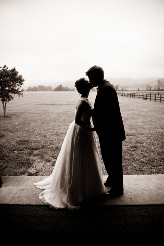 Romantic wedding photo of bride and groom kissing