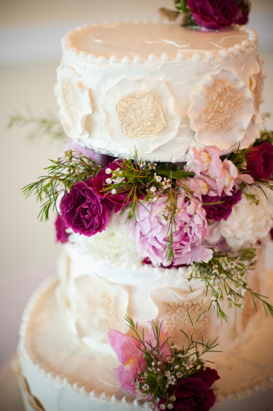 Elegant ivory wedding cake with pink wedding flowers