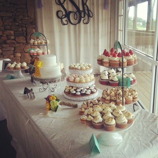yellow bow wedding cake on dessert table