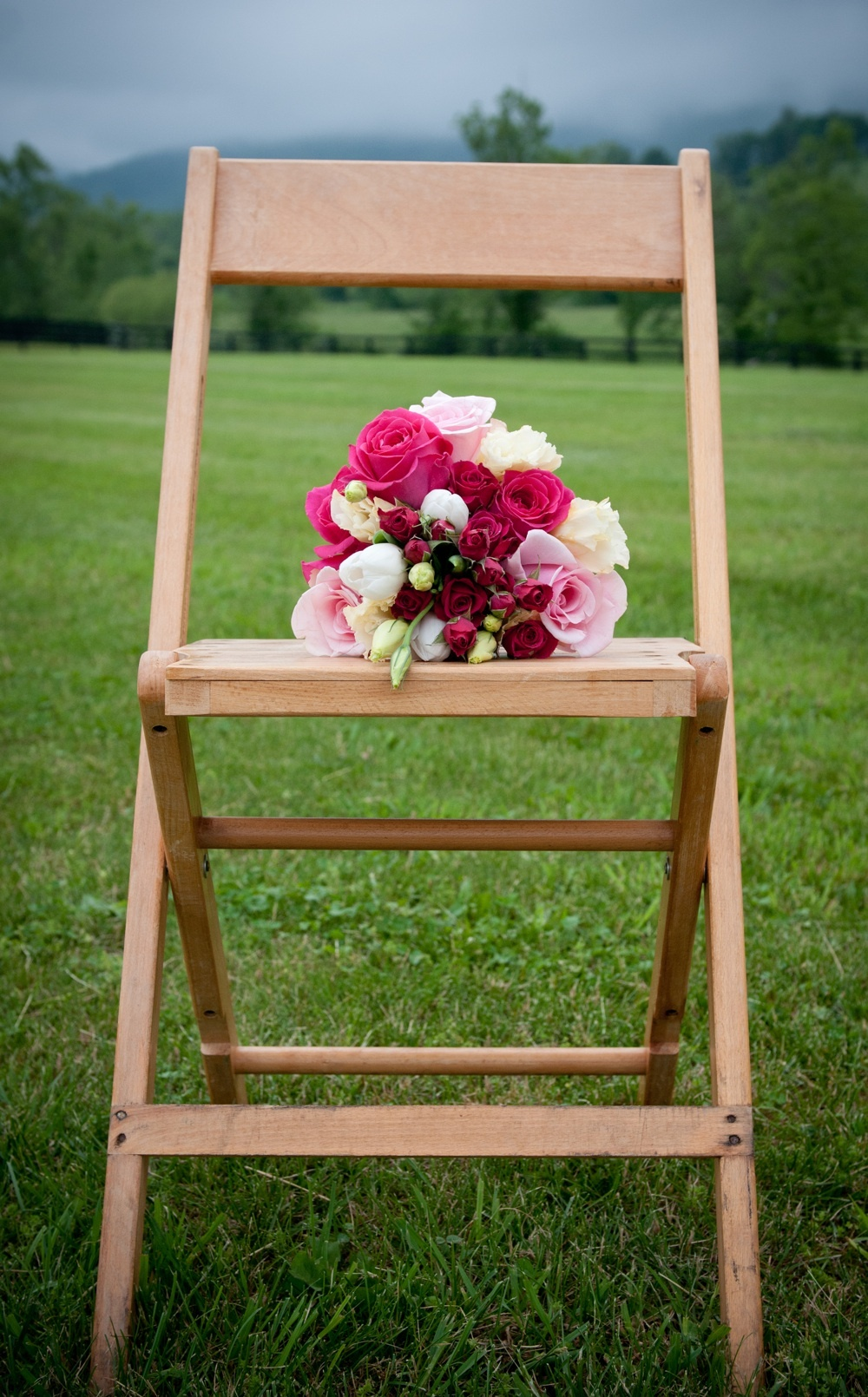 Pink bridal bouquet photographed outside winery wedding venue