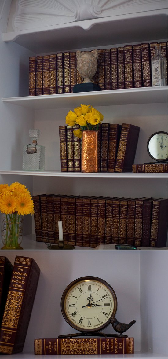 Vintage bookshelf adorned with yellow wedding flowers