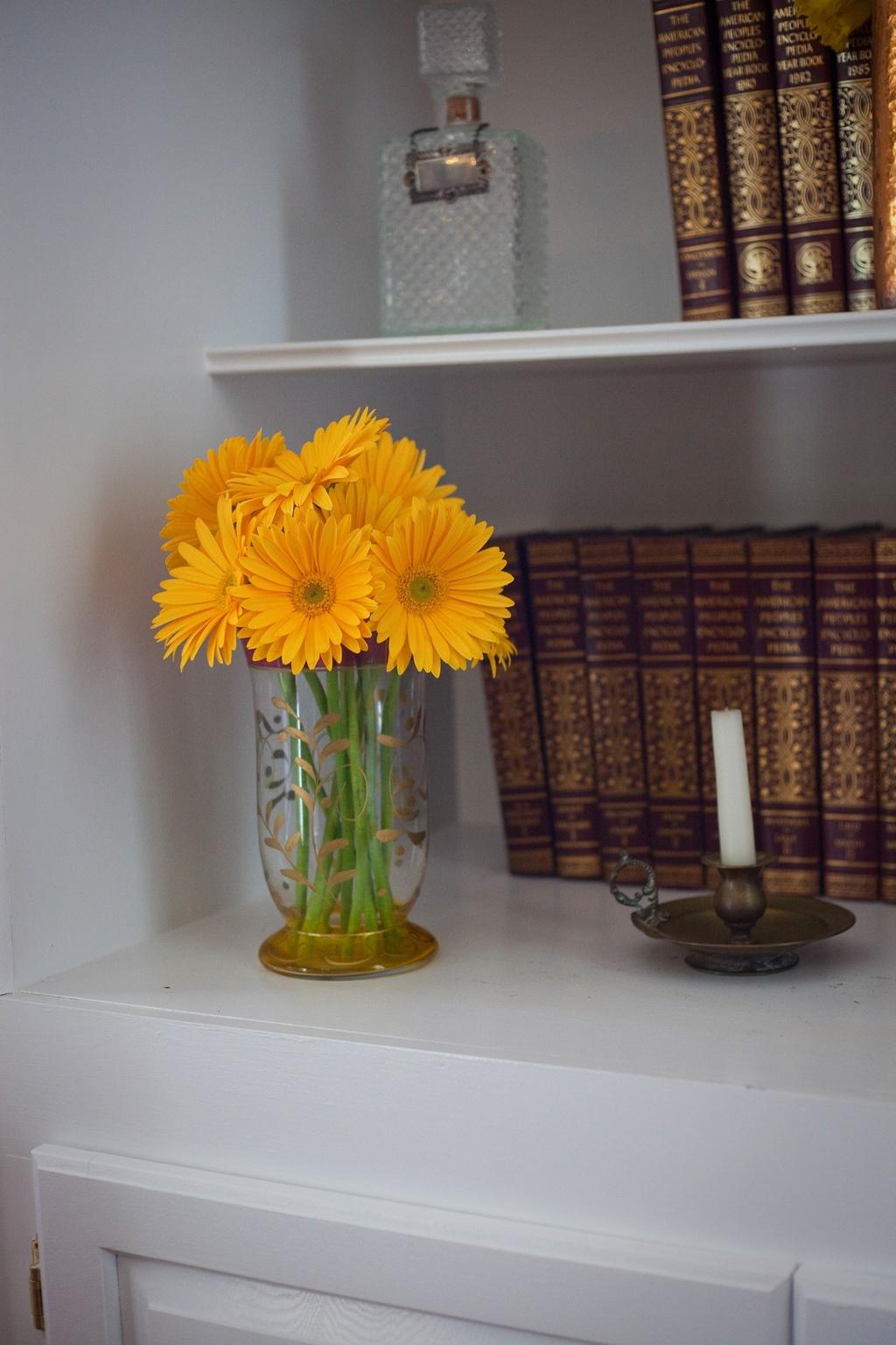 Metallic-wedding-trends-vintage-bookshelfs-yellow-wedding-flowers-gerbera-daisies-5.full