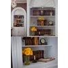 Vintage-wedding-reception-decor-bookshelf-at-wedding-venue-yellow-wedding-flowers.square