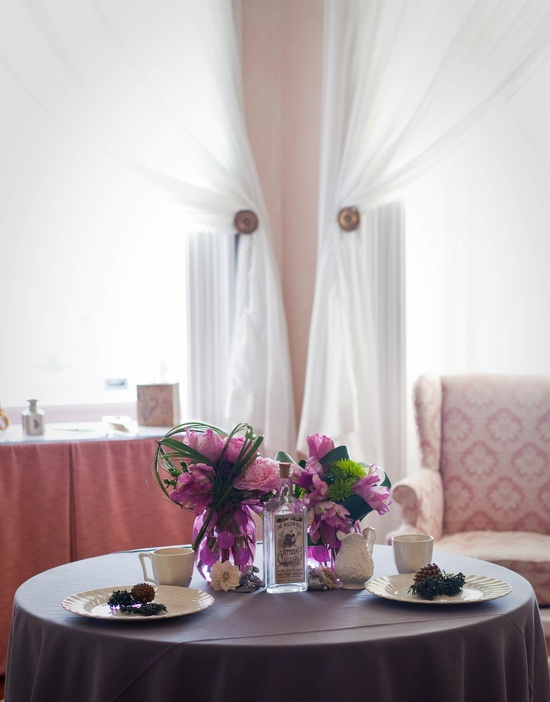 Pink peony wedding flower centerpieces with solid table linens