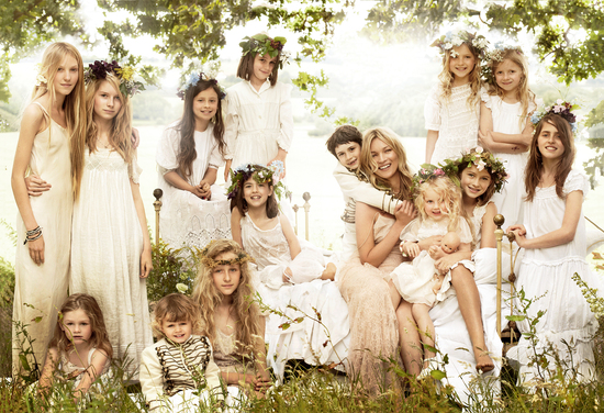 Kate Moss poses with bridal party of 16 bridesmaids and flower girls