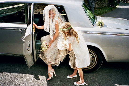 Bride-to-be Kate Moss exits wedding car with help from flower girl