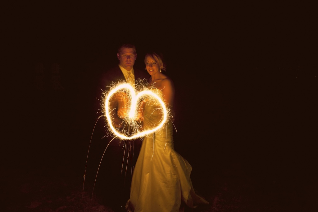 Bride and groom make heart with sparklers after saying I Do!