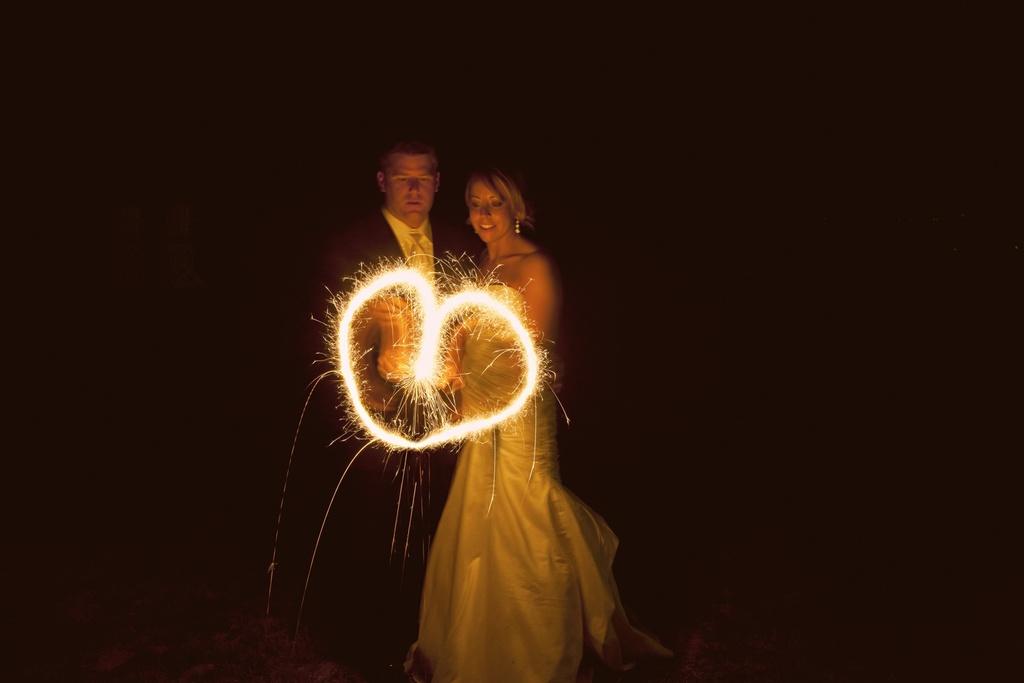 Destination-bride-groom-mermaid-wedding-dress-sparklers-on-beach.full