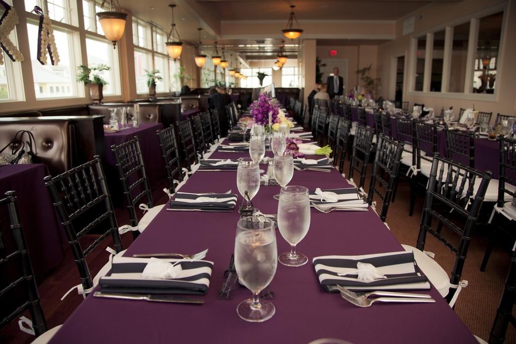 black ivory and purple wedding reception decor