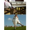Bride-wears-ivory-wedding-dress-cowboy-boots-poses-with-groom.square