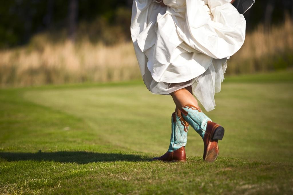 Destination-bride-wears-wedding-dress-cowboy-boots.full