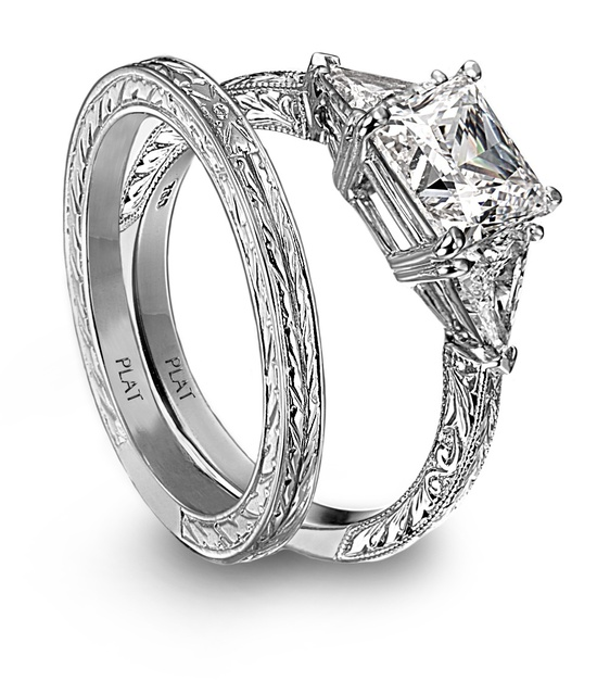 Princess cut platinm and diamond engagement ring and engraved wedding band
