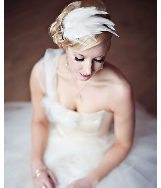 Romantic bridal feather fascinator and one-shoulder wedding dress
