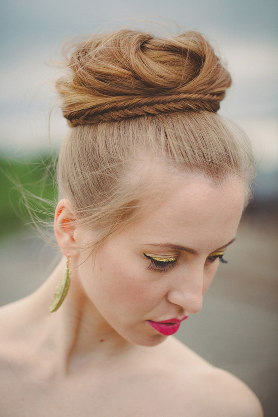 high bridal bun wrapped with fishtail braid