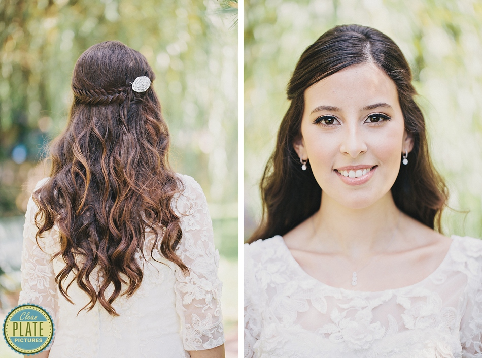 Half Up Wavy Wedding Hairstyle With Braided Accent And Crystal Clip