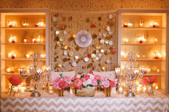 gold and pink romantic wedding backdrop and sweetheart table