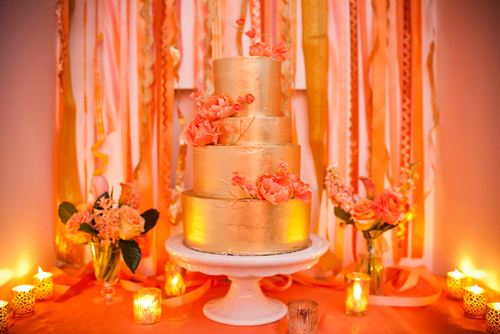 romantic gold foil wedding cake with coral peonies