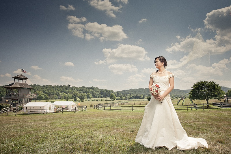 Gorgeous asian bride poses outside for wedding for Outdoor wedding photography poses
