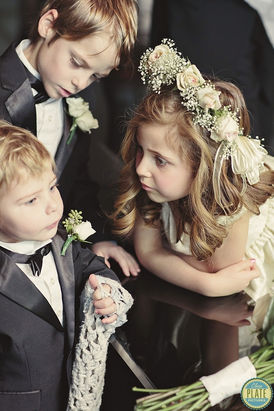 flower girl and ring bearers share a special moment
