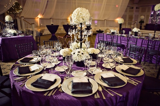 Elegant purple and ivory wedding reception decor