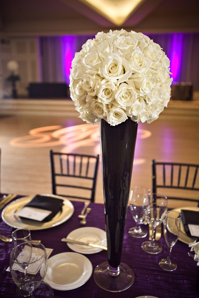 rose flower ball atop chic black vase for wedding reception ...
