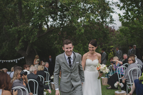 groom wears light gray suit navy tie with white shirt