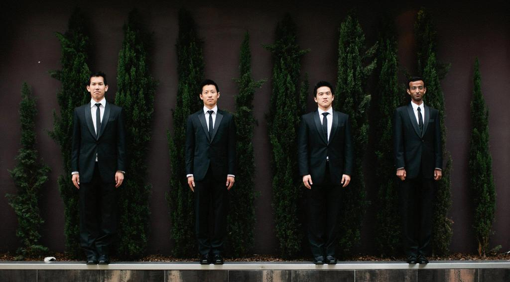 Classic-groom-and-groomsmen-in-black-tuxedos.full