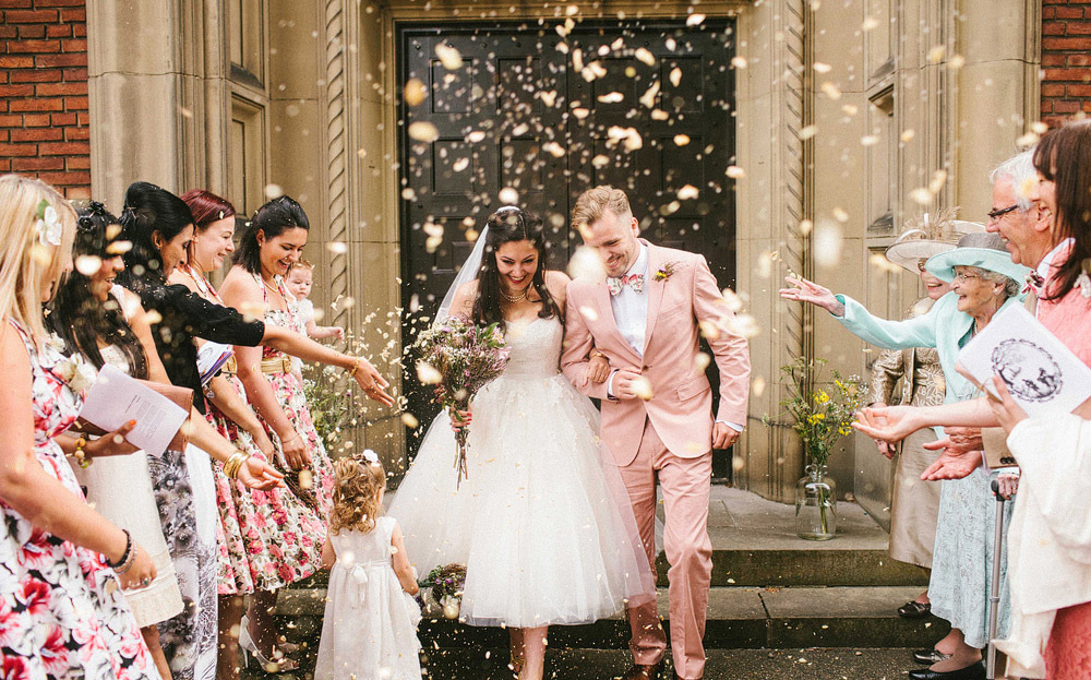 Groom Exits Ceremony Church With His Bride Wearing Pale