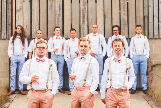 unique groom and groomsmen attire with pastels bow ties and suspenders