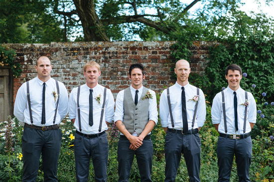 groom and groomsmen in navy pants and suspenders for casual outdoor I Dos