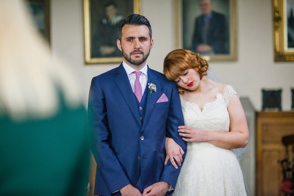 navy grooms suit with pink tie and pocket square