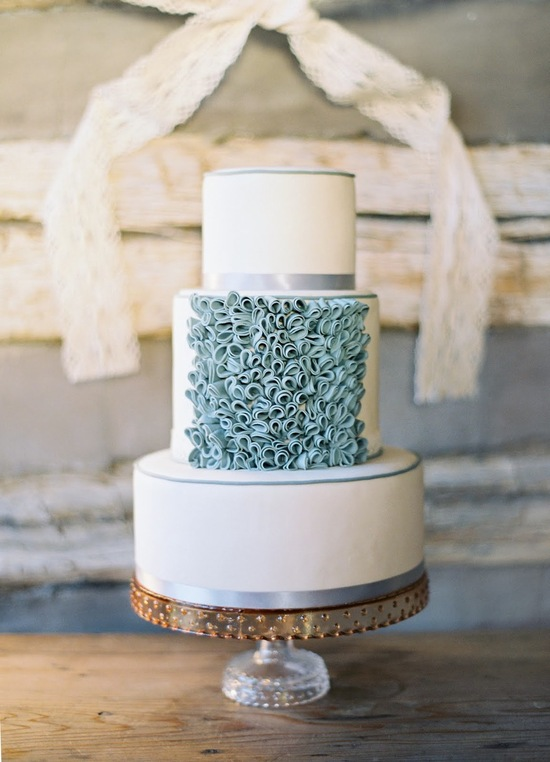 Classic white wedding cake with whimsical textured applique
