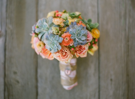 Whimsical and eco-friendly, this succulent bridal bouquet is gorgeous