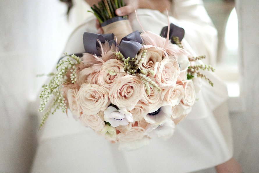 Soft ivory bridal bouquet with whimsical touches