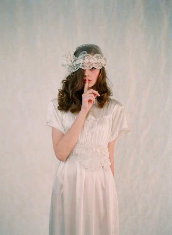 Vintage bride wears lace bridal cap, sheath wedding dress