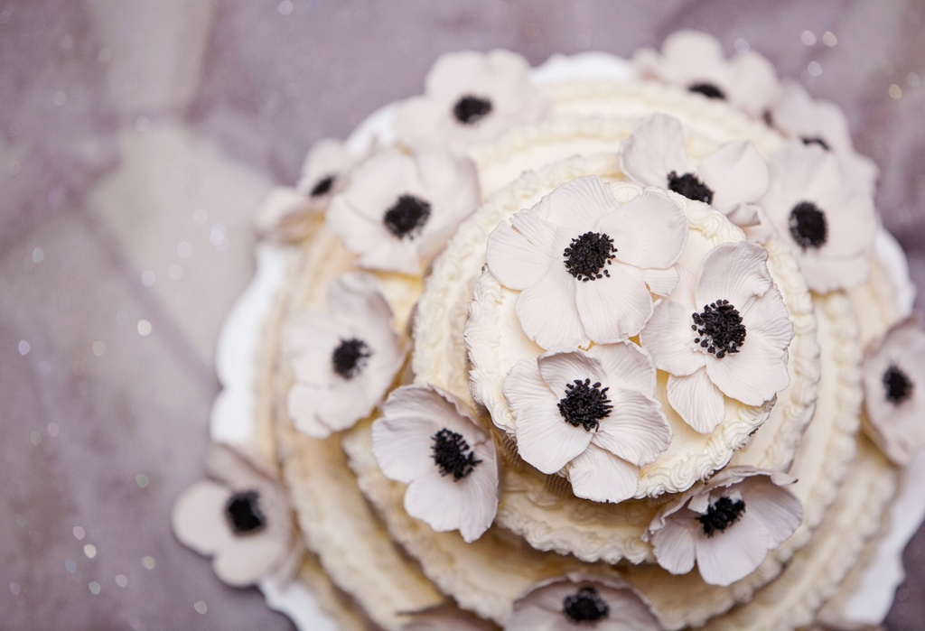 Elegant ivory wedding cake with sugar anemone flowers