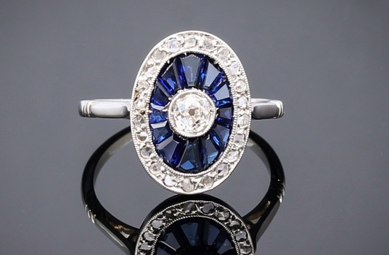 oval shaped art deco engagement ring with diamonds and sapphires